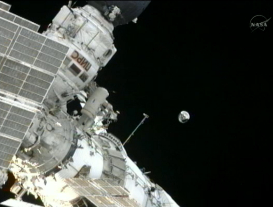 Space Station Cosmonauts Toss Satellite Overboard in Spacewalk