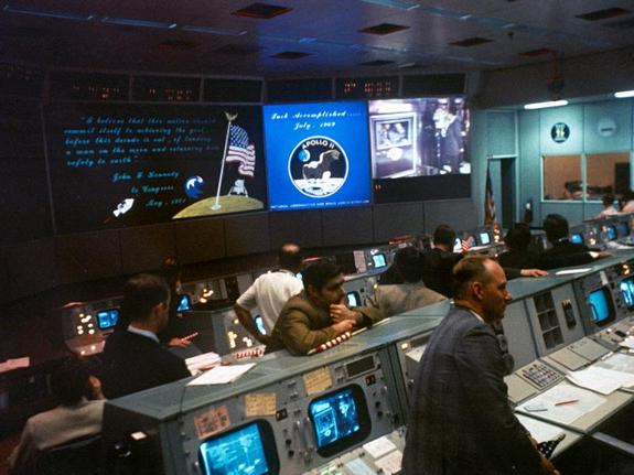 The Mission Operations Control Room in the Mission Control Center at the conclusion of the Apollo 11 lunar landing mission.