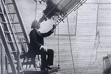 Astronomer Percival Lowell looks through the Clark Telescope.