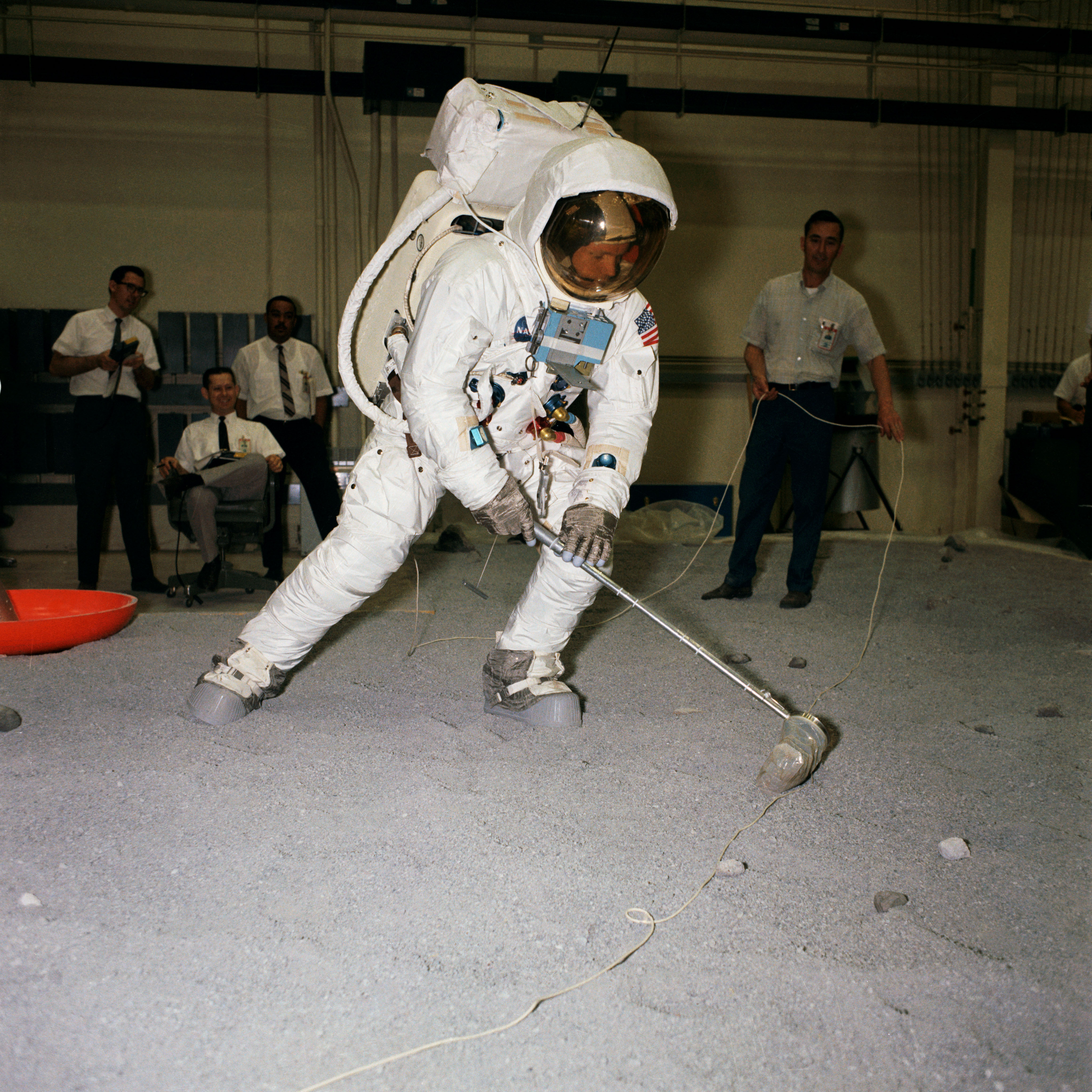 Neil Armstrong Tests Moon Rock Grabbing