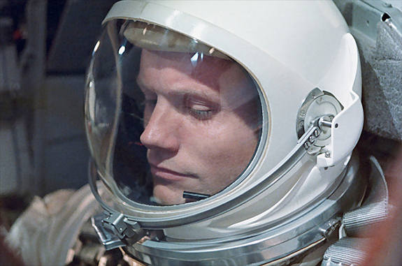 "Neil Armstrong, seen here aboard Gemini 8, was the first U.S. civilian to fly into orbit. Armstrong had retired from the U.S. Navy in 1960. This photo was relatively rarely-seen until it was used as the cover of Armstrong's authorized biography, ""First Man"" by James Hansen. [<a href=http://www.collectspace.com/news/news-082712a.html>More photos at collectSPACE.com</a>]."