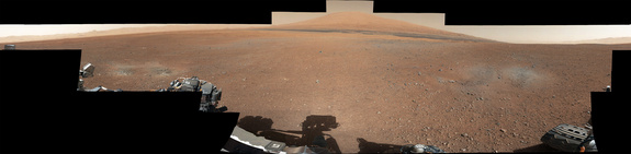 This color panorama shows a 360-degree view of the landing site of NASA's Curiosity rover, including the highest part of Mount Sharp visible to the rover. That part of Mount Sharp is approximately 12 miles (20 kilometers) away from the rover. Scientists enhanced the color in one version to show the Martian scene as it would appear under the lighting conditions we have on Earth, which helps in analyzing the terrain. Photo released August 27, 2012.