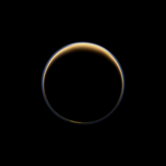 NASA's Cassini spacecraft looks toward the night side of Saturn's moon Titan and sees sunlight scattering its atmosphere, forming a colorful ring. The images were acquired on June 6, 2012, when Cassini was about 134,000 miles from Titan. Image scale is 8 miles per pixel.