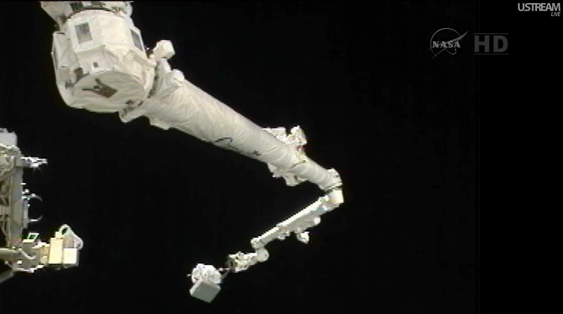 Spacewalker Akihiko Hoshide on Space Station Robotic Arm