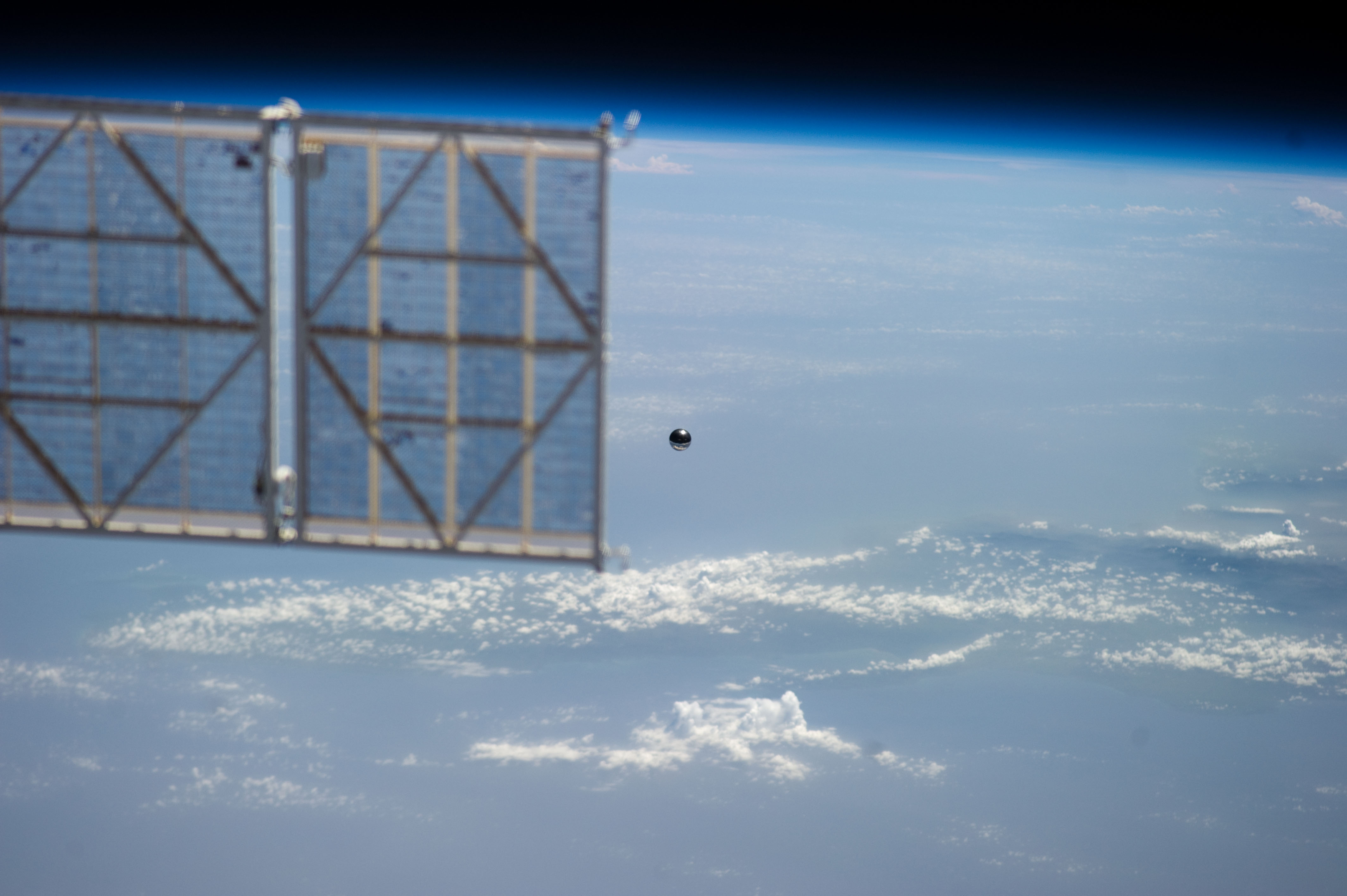 Ball-Shaped Satellite Next to ISS Panel