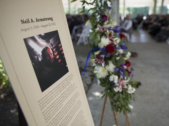 A memorial tribute from the Smithsonian is seen at the entrance of a private memorial service celebrating the life of Neil Armstrong, Aug. 31, 2012, at the Camargo Club in Cincinnati. Armstrong, the first man to walk on the moon during the 1969 Apollo 11 mission, died Saturday, Aug. 25. He was 82.