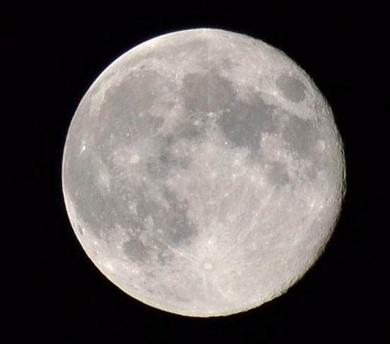 """Thinking of you, Neil,"" wrote Dennis Daniels, who took this blue moon photo to honor the late Neil Armstrong, who died Aug. 25, 2012 a week before this photo was taken."