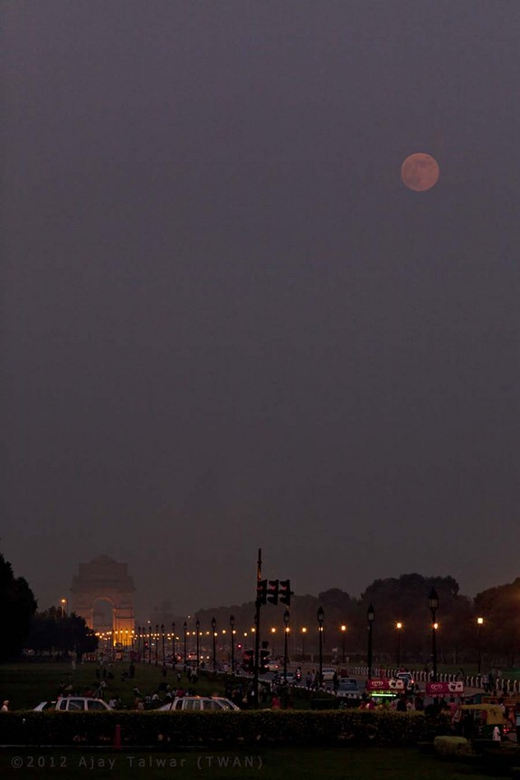 """Yesterday's blue moon was actually reddish when it rose over the Avenue Rajpath, New Delhi,"" wrote photographer Ajay Talwar. ""Actually it was lucky to have been visible at all during the Indian Monsoons."""