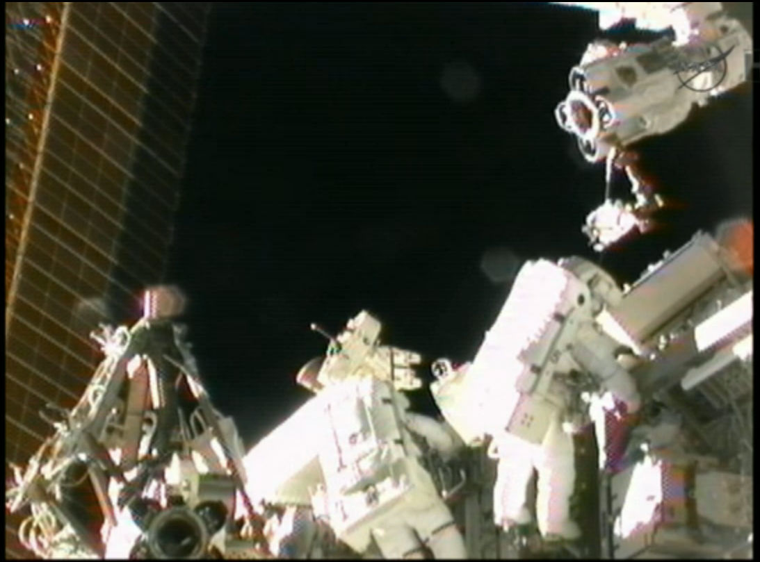 Expedition 32 Spacewalkers Work Near Station Robotic Arm