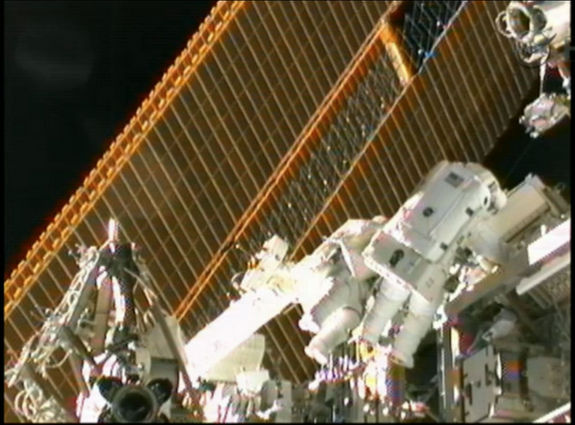 Spacewalkers Sunita Williams (left) and Akihiko Hoshide (right) work near the International Space Station's solar arrays on Sept. 5, 2012.