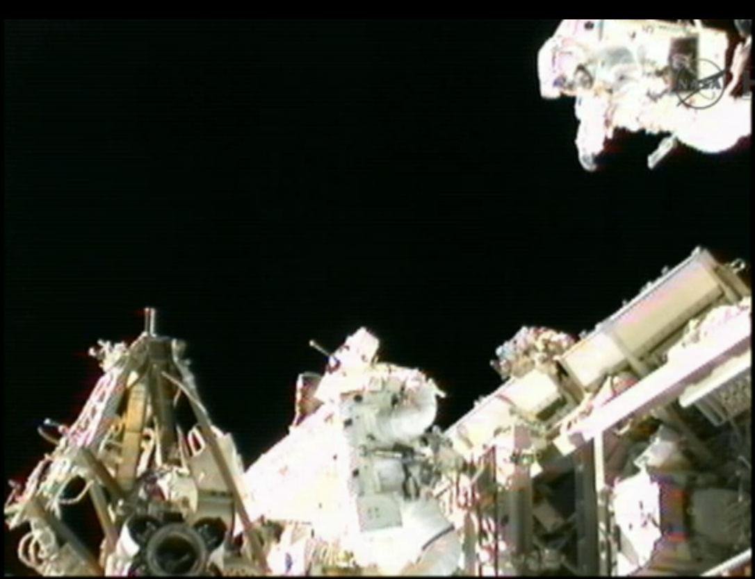 Spacewalker Akihiko Hoshide Rides Station Robotic Arm