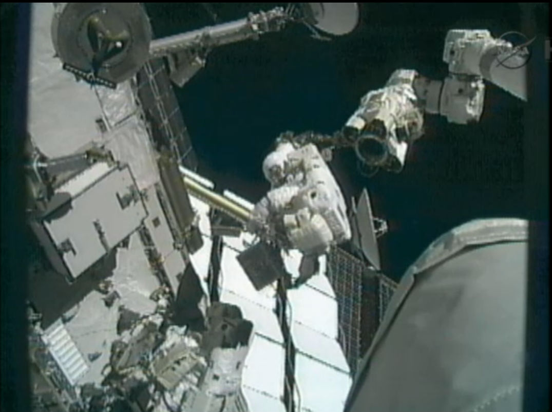 Spacewalker Akihiko Hoshide on the ISS Robotic Arm