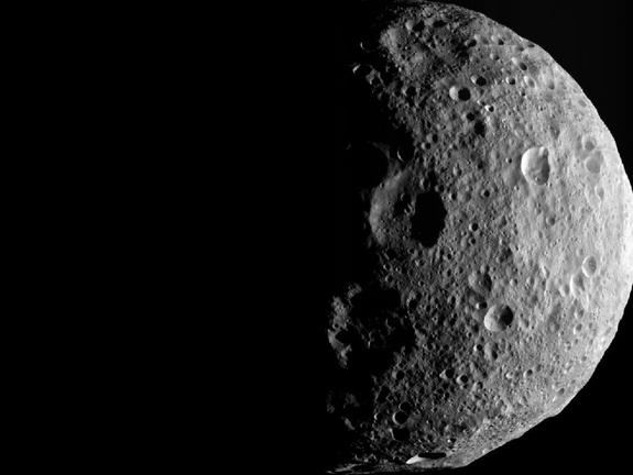 The shadowy outlines of the terrain in Vesta's northern region are visible in this image from NASA's Dawn spacecraft. The image comes from the last sequence of images Dawn obtained of the giant asteroid Vesta as it departed the giant asteroid Sept. 5, 2012.
