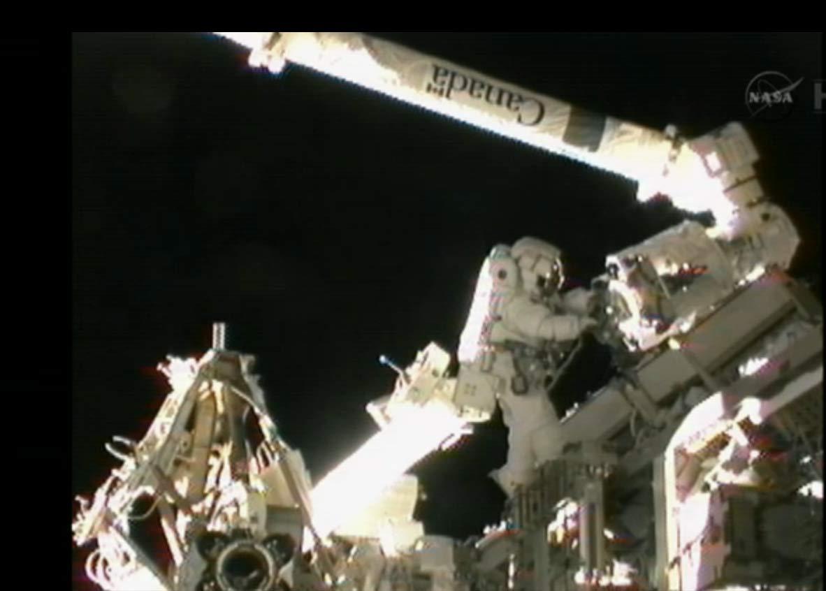 Spacewalker Akihiko Hoshide Near Canadarm2 Robotic Arm