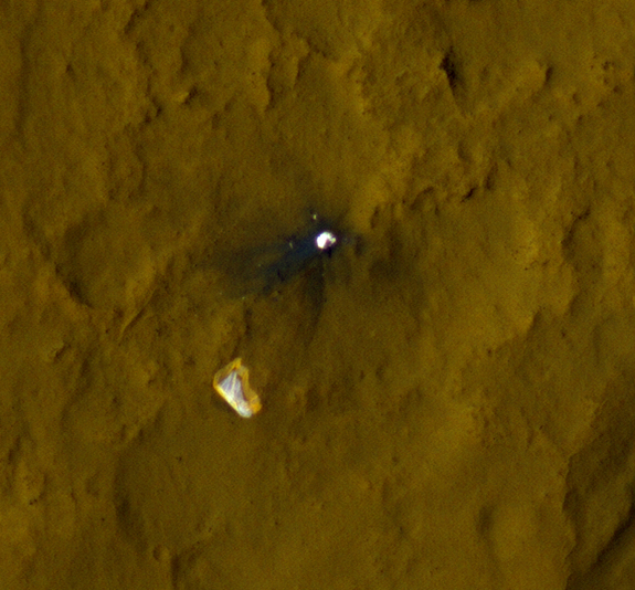 This color view of the parachute and back shell that helped deliver NASA's Mars rover Curiosity to the Red Planet was taken by NASA's Mars Reconnaissance Orbiter. Image released Sept. 6, 2012.
