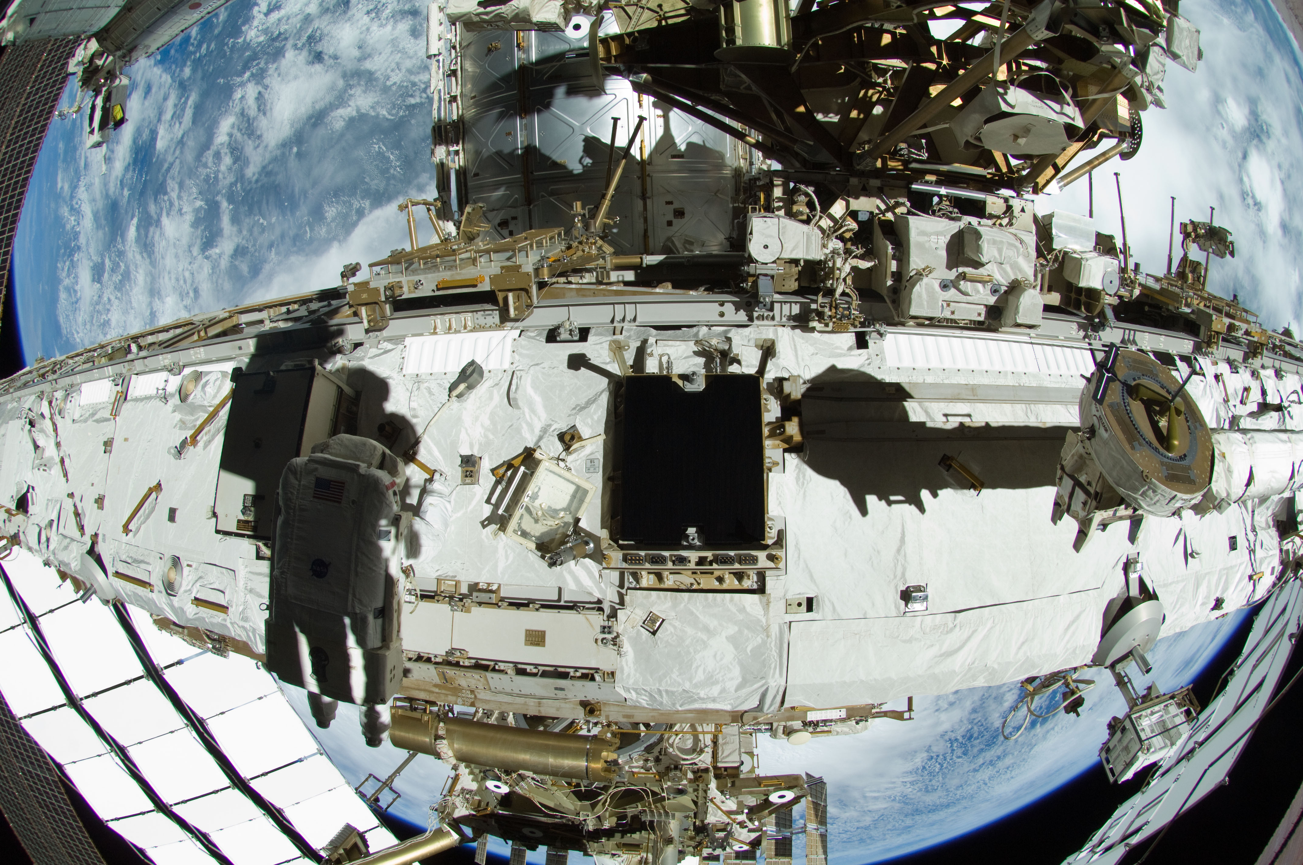 Astronauts Outfitting ISS