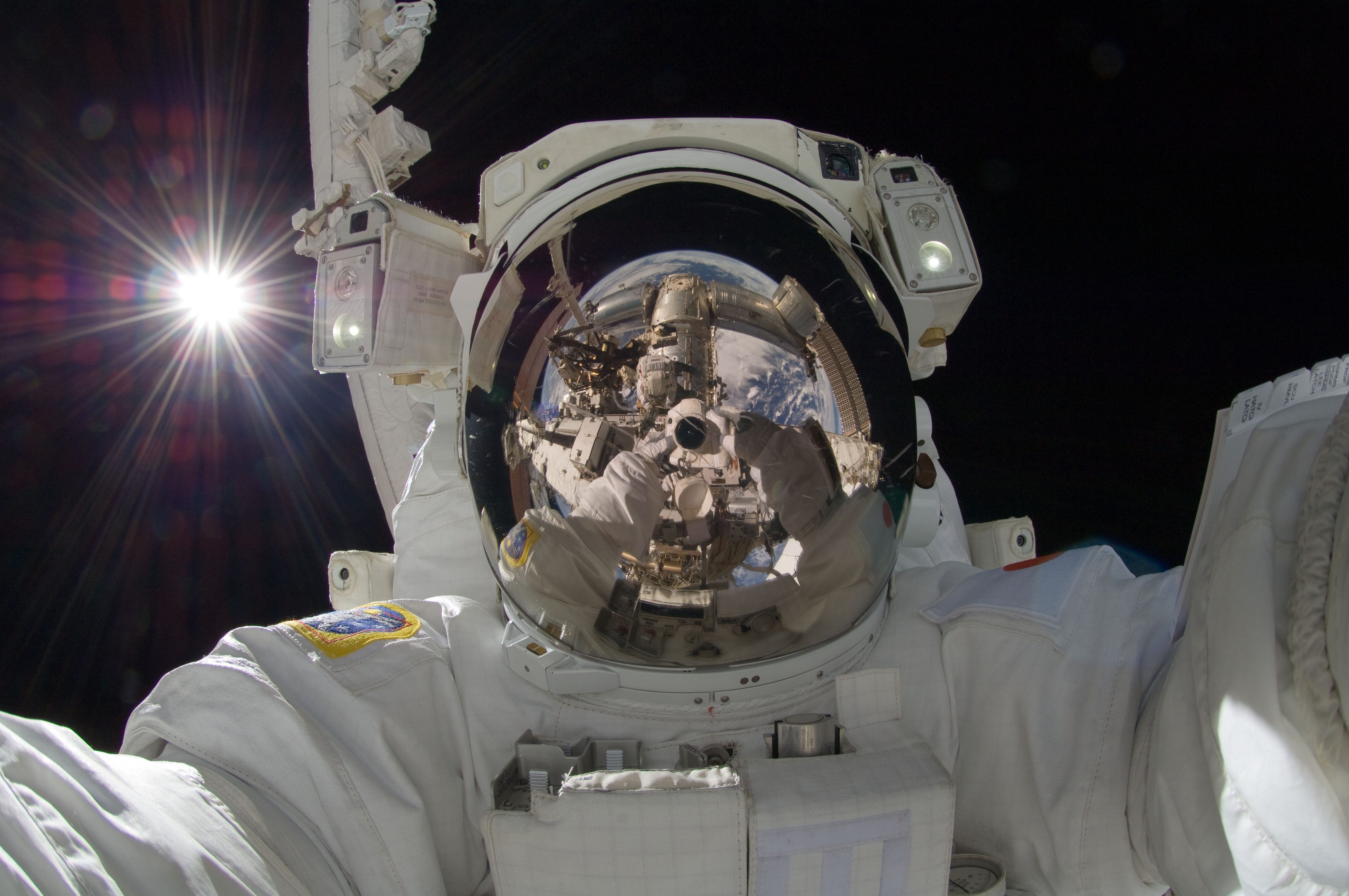 Reflection of ISS Astronaut in a Helmet
