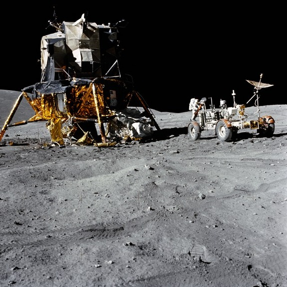 "An excellent view of the Lunar Module (LM) ""Orion"" and Lunar Roving Vehicle (LRV), as photographed by astronaut Charles M. Duke Jr., lunar module pilot, during the first Apollo 16 extravehicular activity (EVA-1) at the Descartes landing site. Astronaut John W. Young, commander, can be seen directly behind the LRV. The lunar surface feature in the left background is Stone Mountain"