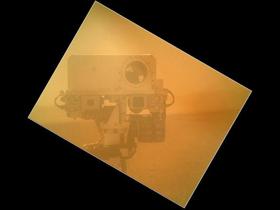 On Sol 32 (Sept. 7, 2012) the Curiosity rover used a camera located on its arm to obtain this self portrait. The image of the top of Curiosity's Remote Sensing Mast, showing the Mastcam and Chemcam cameras, was acquired by the Mars Hand Lens Imager (MAHLI).