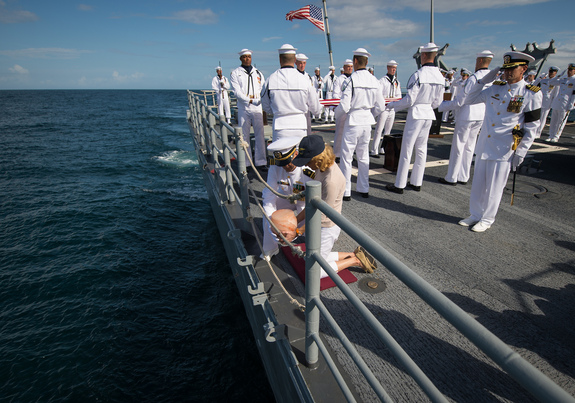 US Navy Lieutenant Commander Paul Nagy, USS Philippine Sea, and Carol Armstrong, wife of Neil Armstrong, commit the cremains of Neil Armstrong to sea during a burial at sea service held onboard the USS Philippine Sea (CG 58), Friday, Sept. 14, 2012, in the Atlantic Ocean. Armstrong, the first man to walk on the moon during the 1969 Apollo 11 mission, died Saturday, Aug. 25. He was 82.