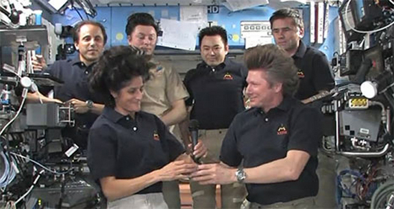 NASA astronaut Sunita Williams (front left) takes command of the International Space Station from cosmonaut Gennady Padalka (front right) during a ceremony marking the start of the Expedition 33 increment aboard the space station on Sept. 15, 2012.
