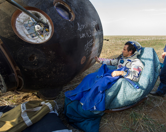 Expedition 32 NASA Flight Engineer signs the side of his Soyuz TMA-04M spacecraft shortly after he landed with his crew mates Expedition 32 Commander Gennady Padalka and Flight Engineer Sergei Revin of Russia in a remote area near the town of Arkalyk, Kazakhstan, on Monday, Sept. 17, 2012. Acaba, Padalka and Revin returned from five months onboard the International Space Station where they served as members of the Expedition 31 and 32 crews.