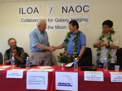 Steve Durst, founding director of ILOA and Jun Yan, Director General of China's NAOC, shake hands after signing agreement on September 4 to collaborate on using future moon landers to carry out science duties from the lunar surface