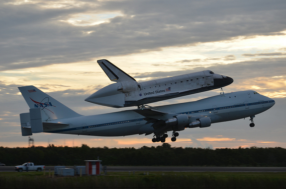 Space shuttle Endeavour, atop its Shuttle Carrier Aircraft, takes off on NASA's last-ever ferry flight from the Kennedy Space Center in Florida on Sept. 19, 2012. Endeavour is headed for Los Angeles, Calif., to be put on public display at the California Science Center.