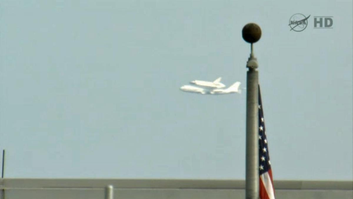 Endeavour Flies Past Flag at JSC