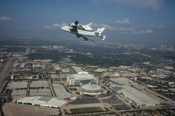Space Shuttle Endeavour is ferried by NASA's Shuttle Carrier Aircraft (SCA) over Houston, Texas on September 19, 2012. NASA pilots Jeff Moultrie and Bill Rieke are at the controls of the Shuttle Carrier Aircraft. Photo taken by NASA photographer Sheri Locke in the backseat of a NASA T-38 chase plane with NASA pilot Thomas E. Parent at the controls.