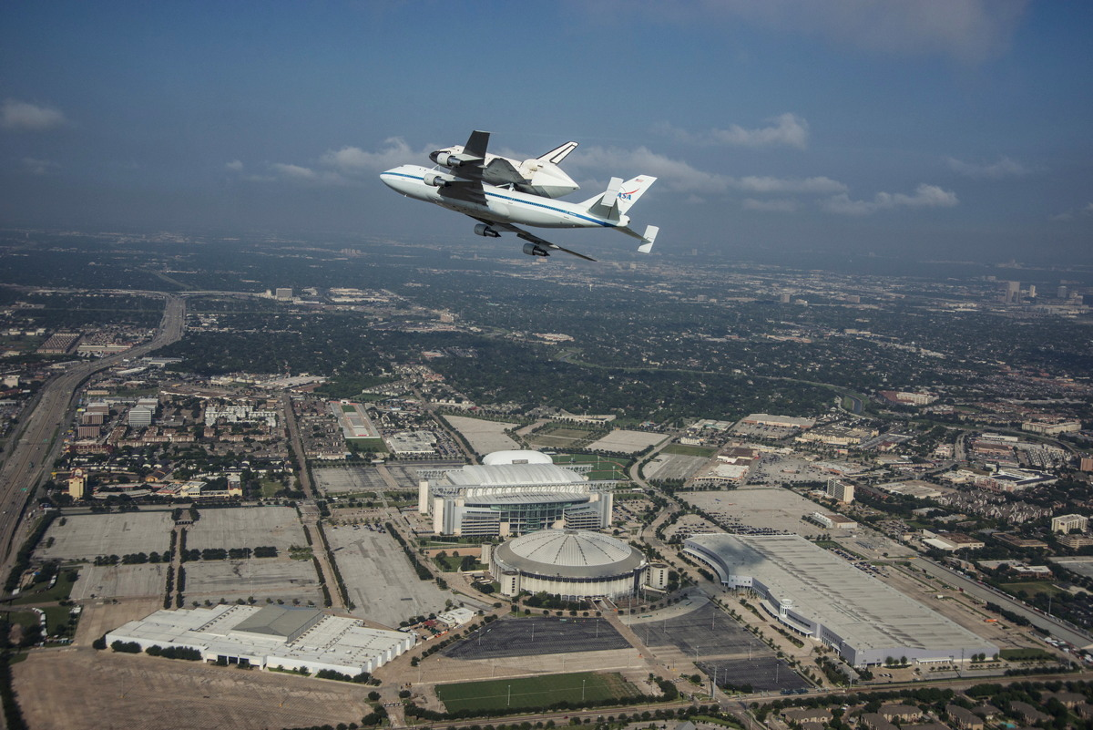 Endeavour over Astrodome and Reliant Stadium