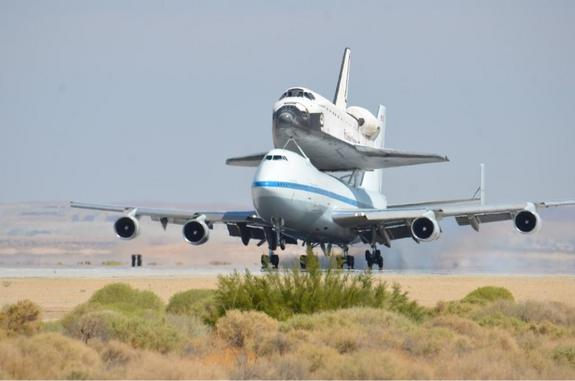 NASA's Space shuttle Endeavour, riding piggyback atop a Shuttle Carrier Aircraft, lands at NASA's Dryden Flight Research Facility in Southern California on Sept. 20, 2012, during the final shuttle ferry flight. Endeavour is headed to Los Angeles, where it will be placed on display at the California Science Center.