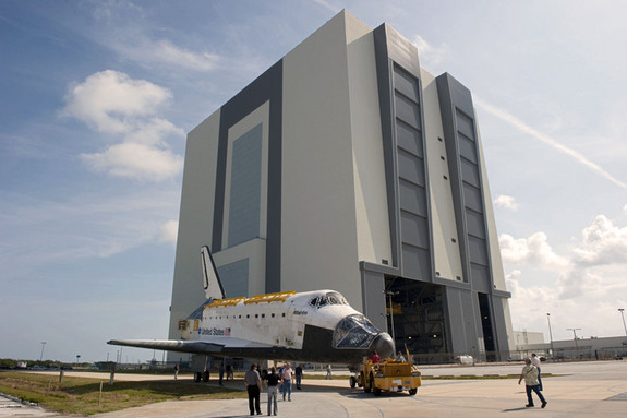 At NASA's Kennedy Space Center in Florida, space shuttle Atlantis is towed from the Vehicle Assembly Building (VAB) before being put on display at the Kennedy Space Center Visitor Complex.