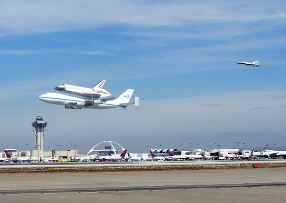NASA's space shuttle Endeavour flies over Los Angeles International Airport while riding piggyback atop its Shuttle Carrier Aircraft on Sept. 21, 2012, during a4.5-hour aerial tour over California. The shuttle was being delivered to L.A., where it is destined to serve as a museum piece at the California Science Center.