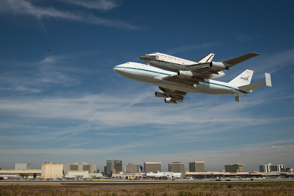 Space shuttle Endeavour, mounted atop a NASA 747 Shuttle Carrier Aircraft (SCA) performs a low flyby at Los Angeles International Airport, Friday, Sept. 21, 2012. Endeavour, built as a replacement for space shuttle Challenger, completed 25 missions, spent 299 days in orbit, and orbited Earth 4,671 times while traveling 122,883,151 miles. Beginning Oct. 30, the shuttle will be on display in the California Science center's Samuel Oschin Space Shuttle Endeavour Display Pavilion, embarking on its new mission to commemorate past achievements in space and educate and inspire future generations of explorers.