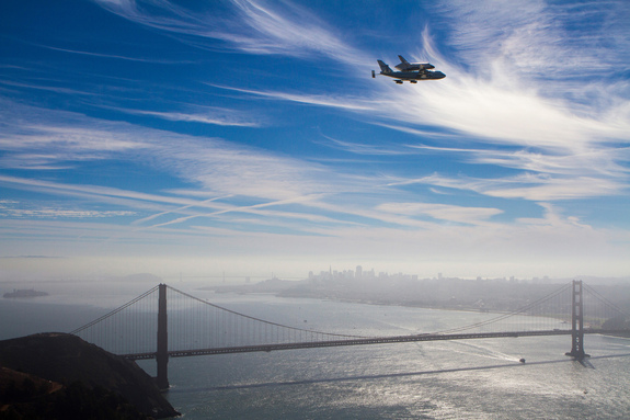 The space shuttle Endeavour flies over the Golden Gate Bridge in San Francisco, CA, Friday, Sept. 21, 2012.