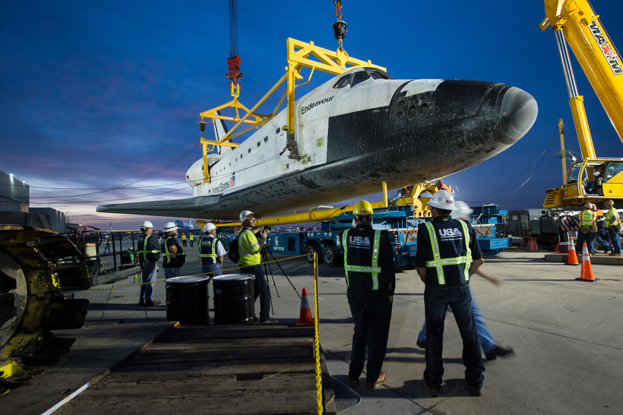 Shuttle Endeavour Hoisted Off Carrier Plane
