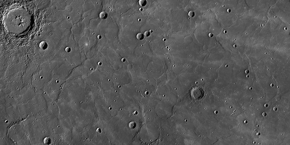 "This view from NASA's Messenger spacecraft orbiting Mercury shows a region of smooth, volcanic plains that have been heavily modified by tectonic structures termed ""wrinkle ridges,"" low, sinuous features that form when lavas cool and subside, causing the crust to contract horizontally. Image released Feb. 10, 2012."