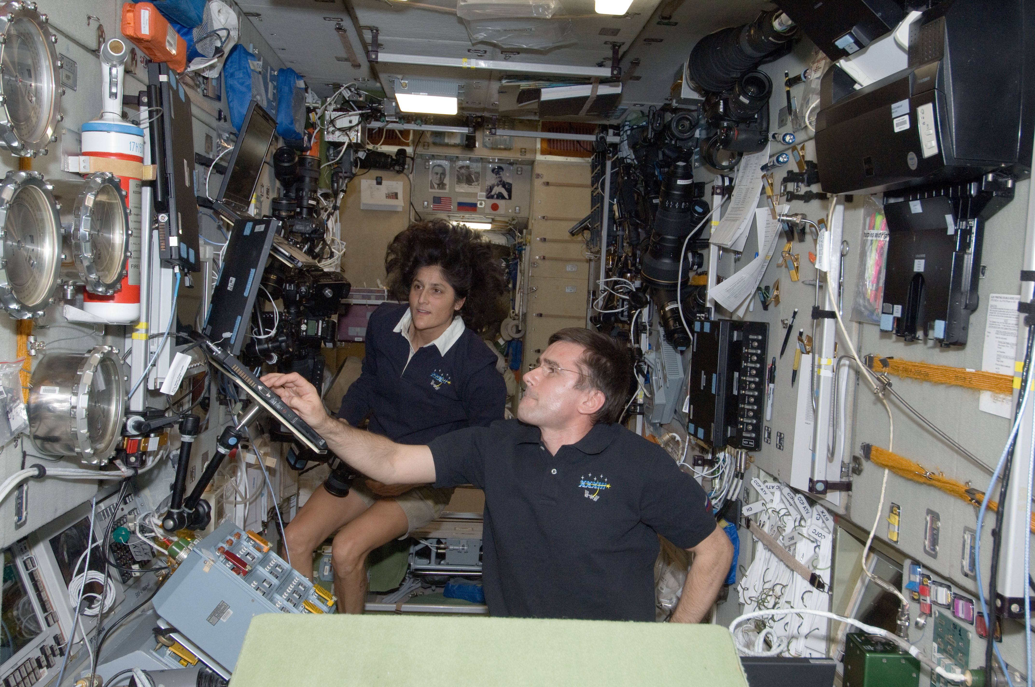 Williams and Malenchenko Work at ISS Zvezda Service Module