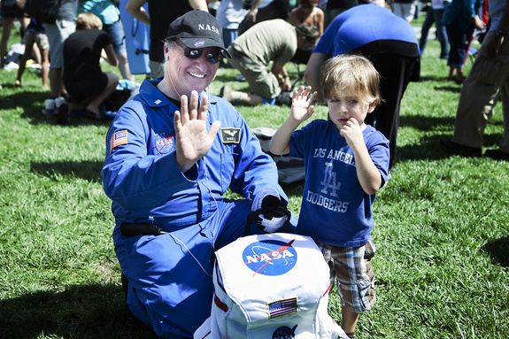 An unidentified man and child were at Griffith Observatory, Los Angeles, for the flyover of shuttle Endeavour on Sept. 21, 2012.