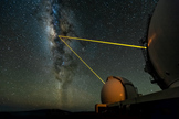 The two W. M. Keck Telescopes on Mauna Kea, Hawaii, observing the galactic center. The lasers are used to create an artificial star in Earth's upper atmosphere, which is then employed to measure the blurring effects of the lower atmosphere (the effect that makes the stars twinkle in the night sky). The blurring gets corrected in real time with the help of a deformable mirror. This is the so-called adaptive optics technique. Image released October 4, 2012.