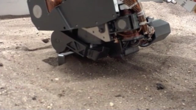 Curiosity's Robotic Scoop Arm In Action