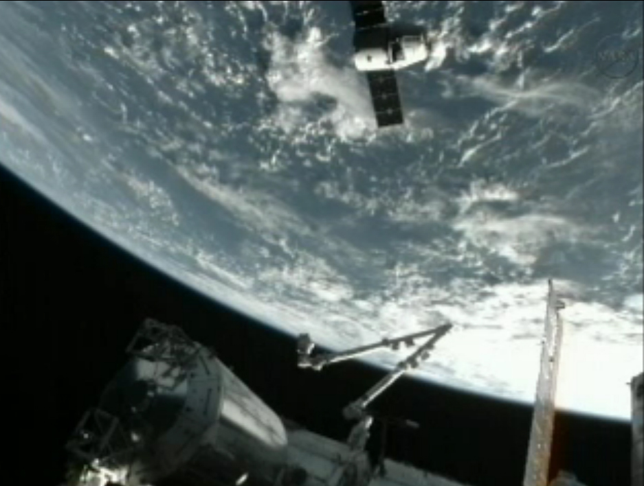 SpaceX Dragon Soars Over Earth