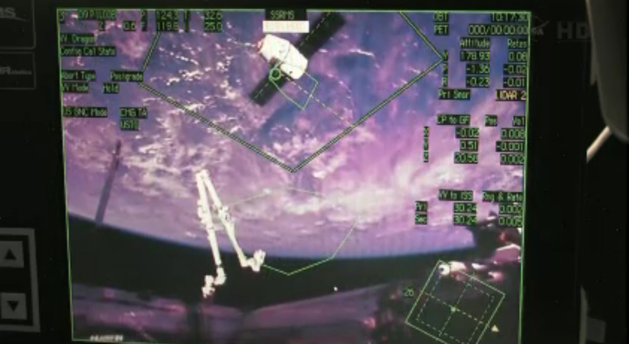 Station Astronaut View of Dragon Spacecraft