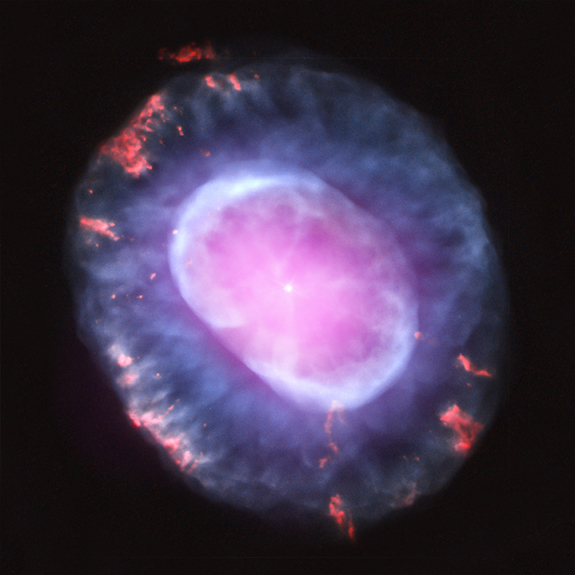 This image is of planetary nebula NGC 7662 as seen with the Chandra X-Ray Observatory. A planetary nebula is a phase of stellar evolution that the sun should experience several billion years from now, when it expands to become a red giant and then sheds most of its outer layers, leaving behind a hot core that contracts to form a dense white dwarf star. This image was released Oct. 10, 2012.