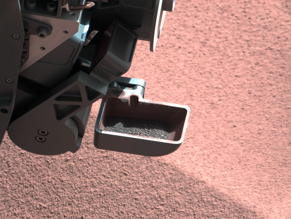 A sample of Mars dirt is shown in the scoop instrument of NASA's Curiosity Mars rover. The rover began using its scoop in October 2012, and this photo was taken by Curiosity's right Mast Camera (Mastcam-100) on Oct. 10, 2012, the 64th sol, or Martian day, of operations.