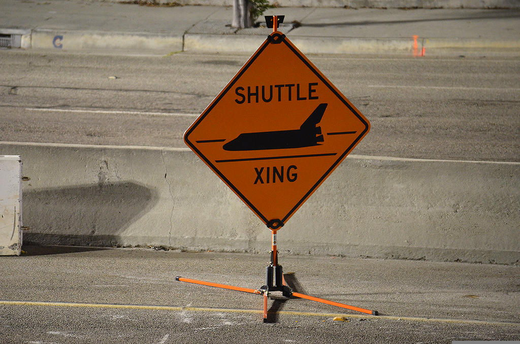 Shuttle ×ing Sign