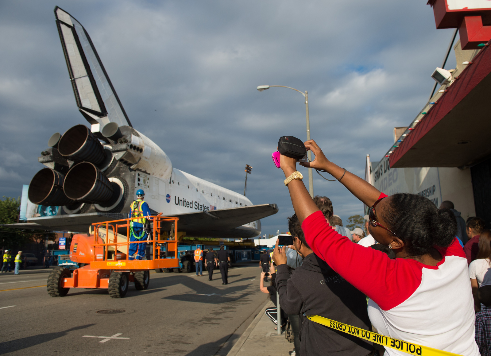 Spectators photograph shuttle Endeavour in Inglewood on Oct. 12, 2012.