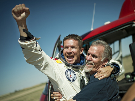 Skydiver Felix Baumgartner of Austria and Technical Project Director Art Thompson of the Unites States celebrate after successfully completing the world's highest skydive, a supersonic leap,  for Red Bull Stratos in Roswell, New Mexico, on Oct. 14, 2012.