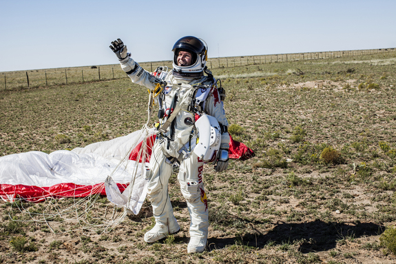 Pilot Felix Baumgartner of Austria celebrates after successfully completing the world's highest skydive, a supersonic leap,  for Red Bull Stratos in Roswell, New Mexico, on Oct. 14, 2012.